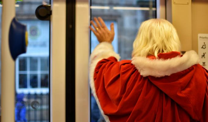 Santa waving out of tram window